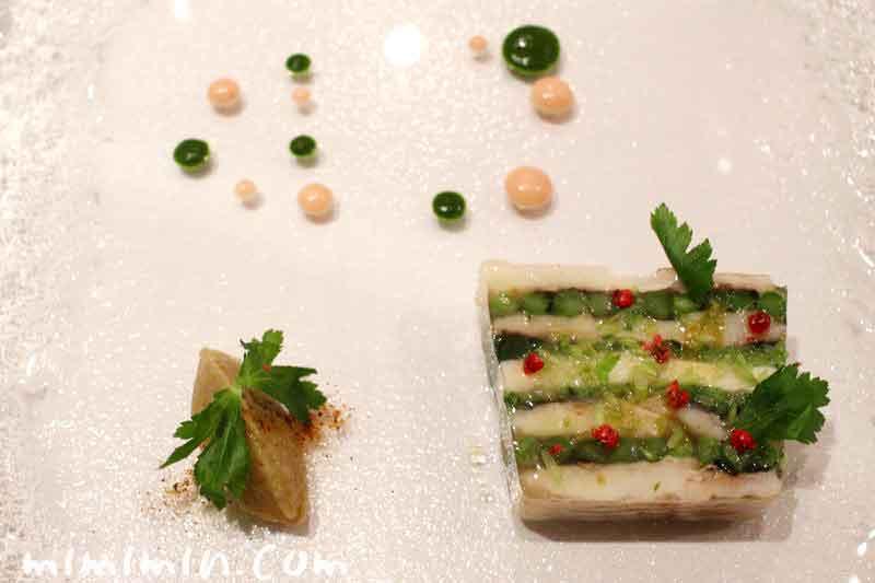 活〆鱧と水菜、長芋、インゲンのテリーヌ・レザンファン ギャテの写真