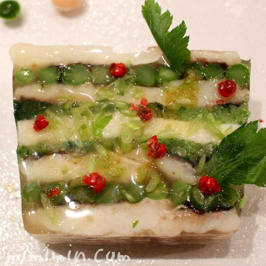 活〆鱧と水菜、長芋、インゲンのテリーヌ・レザンファン ギャテのテリーヌの写真
