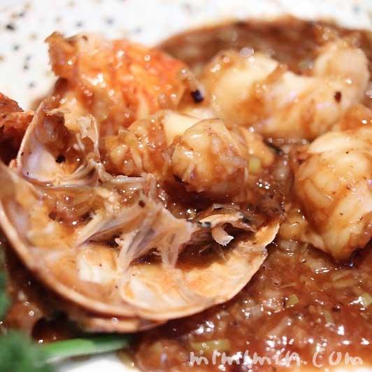 イセエビの黒豆ソース炒め|星ヶ岡(ザ・キャピトルホテル 東急・中華)の画像
